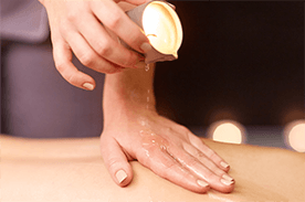 MASSAGE-WITH-HOT-CANDLE-OIL